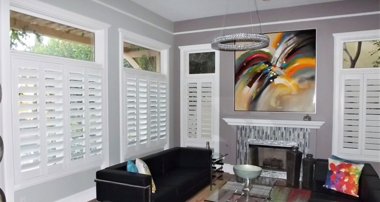 White plantation shutters in living room