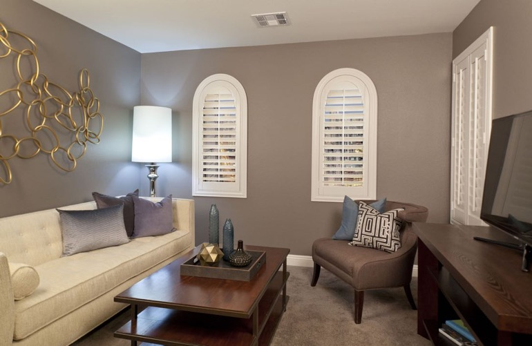 Phoenix family room with arced plantation shutters.