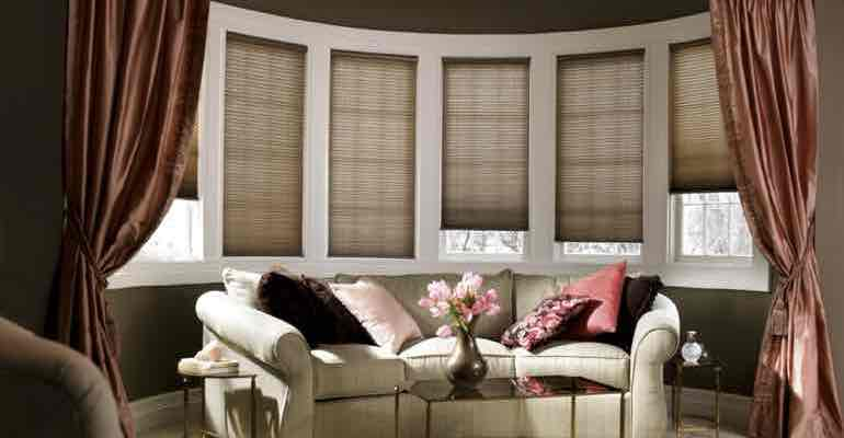 Brown cellular shades in lounge bow window.