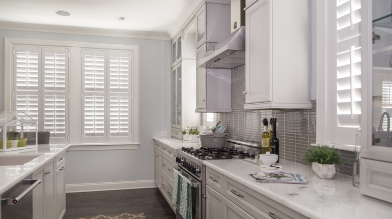 White shutters in Phoenix kitchen with marble counter.