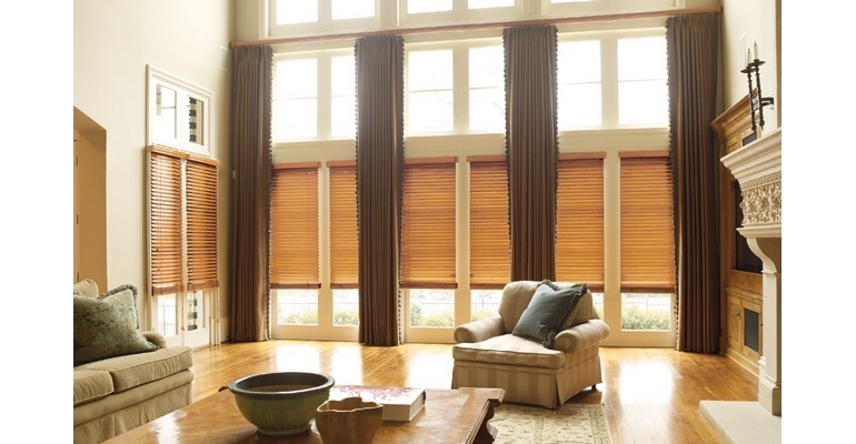 Phoenix great room with natural wood blinds and floor to ceiling drapes.
