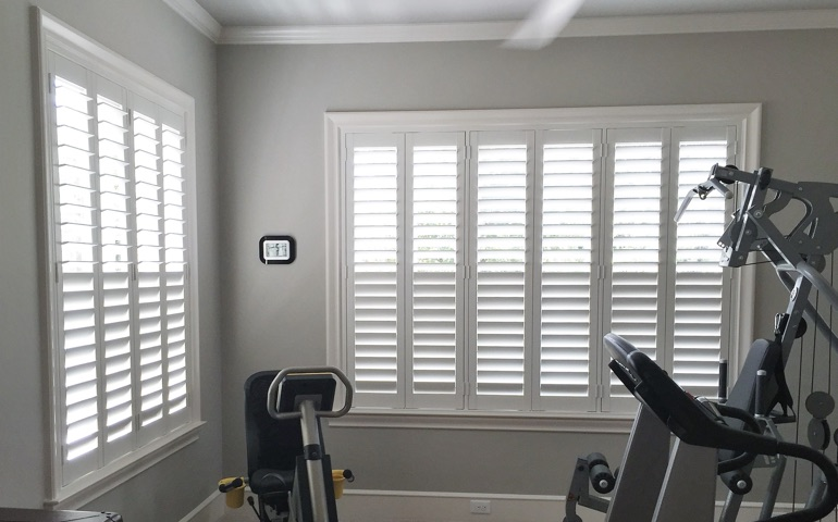 Phoenix fitness room with shuttered windows.