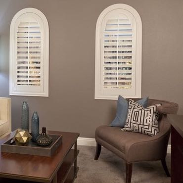 Phoenix family room arched shutters.