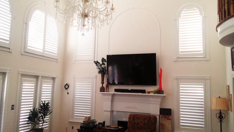 Phoenix Great Room With Wall Mounted Television And High Ceiling Windows