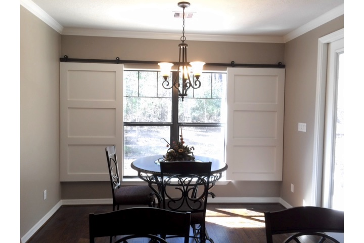 Phoenix dining room with classic barn door shutters.