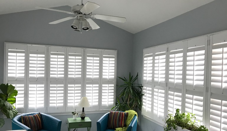 Phoenix living room with fan and shutters