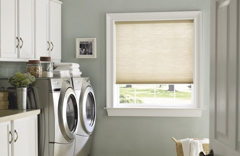 Phoenix laundry room with beige window shades.