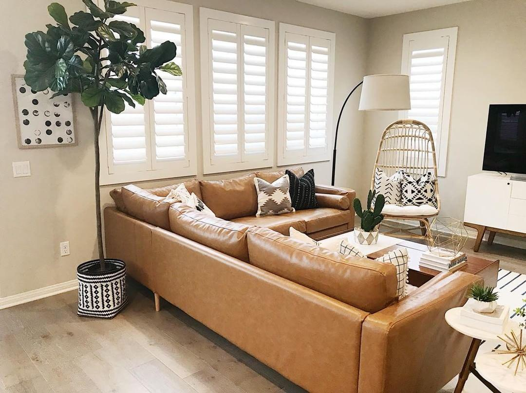 Warm living room with Polywood shutters in Phoenix.
