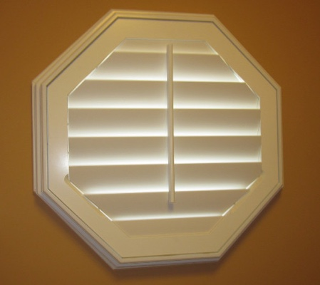 Phoenix octagon window with white shutter