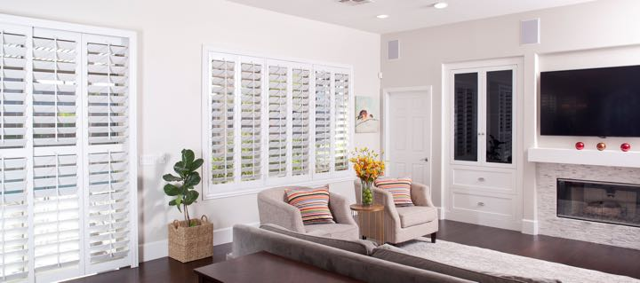 Phoenix living room in white with plantation shutters.