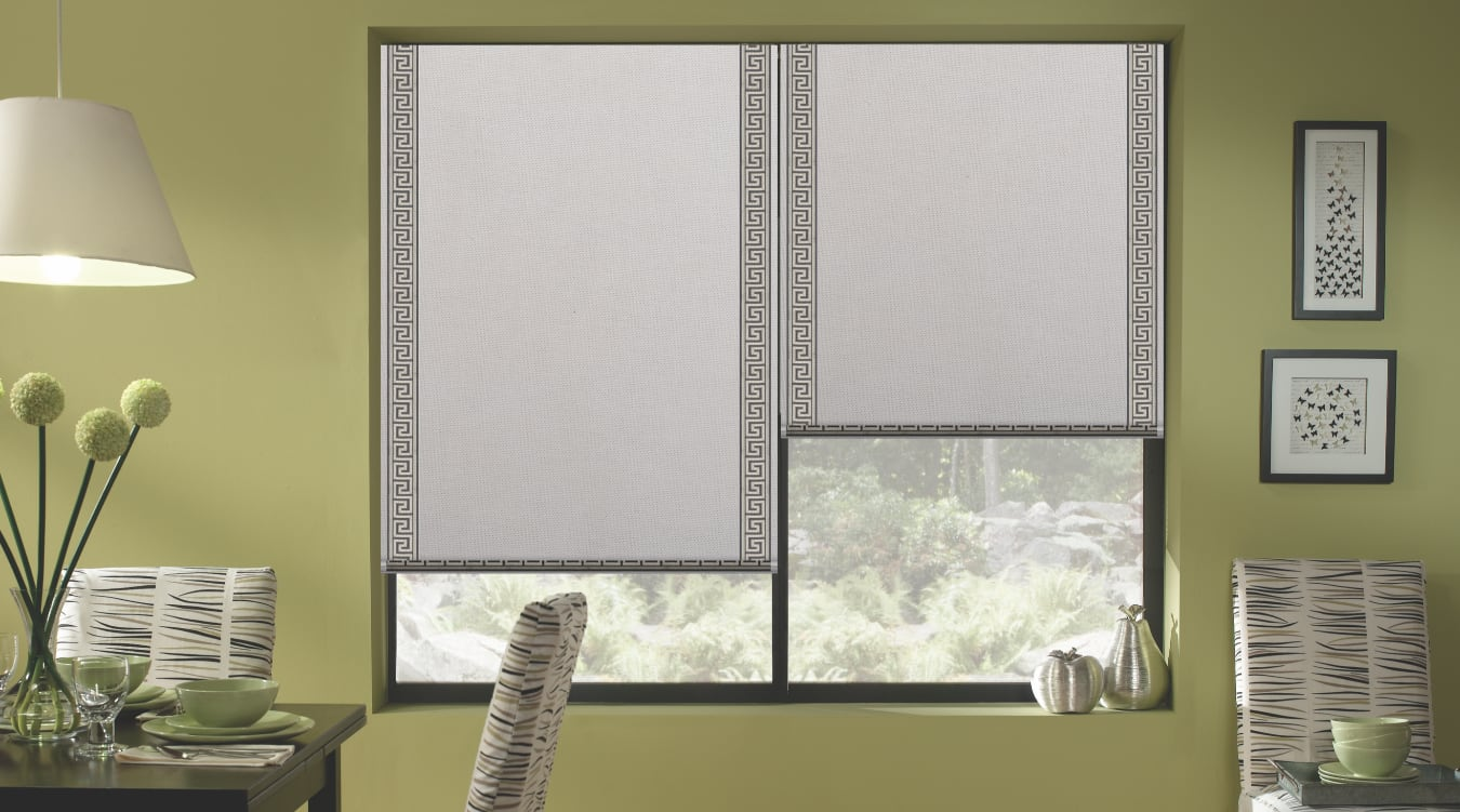 Motorized roller shades in a dining room.
