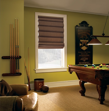 Roman shades in Phoenix pool room with green walls.
