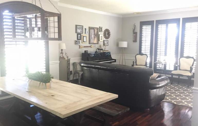 Natural Wood shutters in living room windows by Sunburst Shutters Phoenix.