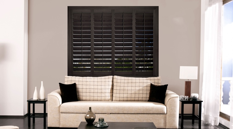 Phoenix living room with black shutters.