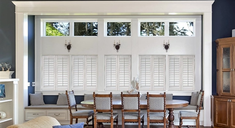 Phoenix great room with shut plantation shutters.