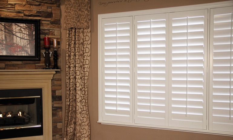 Phoenix Studio plantation shutters in living room.