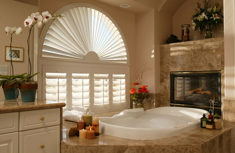 Arched shutters in a Phoenix bathroom.