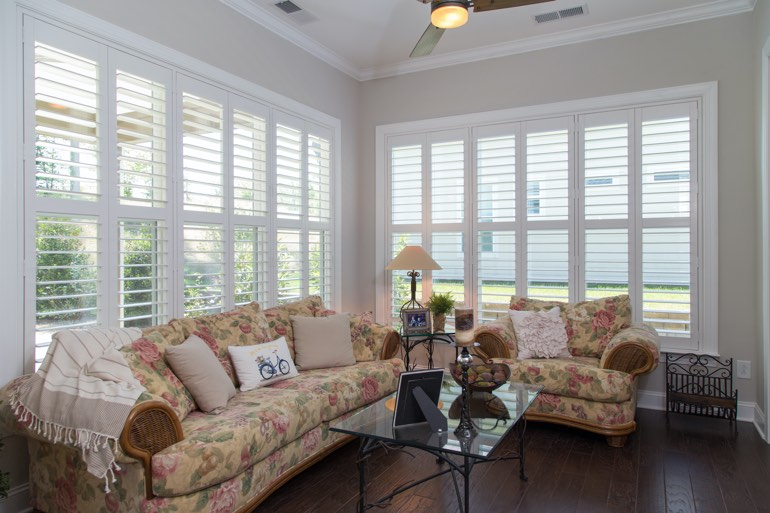 Sunroom with faux wood shutters in Phoenix.