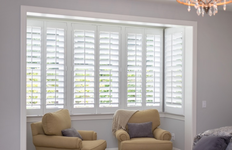 White plantation shutters in sitting area