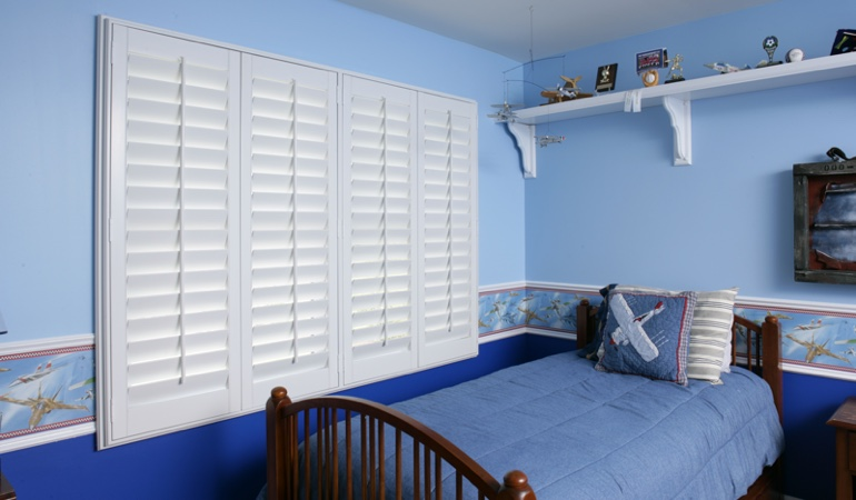 White plantation shutters in blue kids bedroom in Phoenix