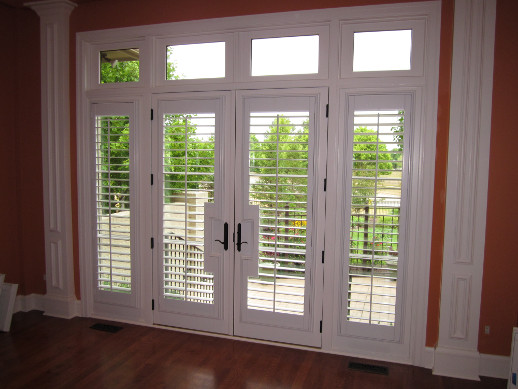 Phoenix patio door with sidelight shutters
