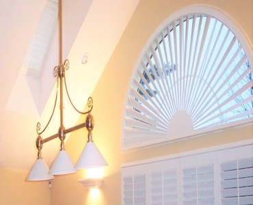 Phoenix arched eyebrow window with plantation shutter