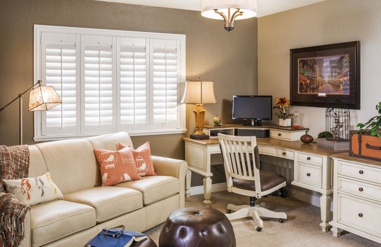 Phoenix home office with white window shutters.