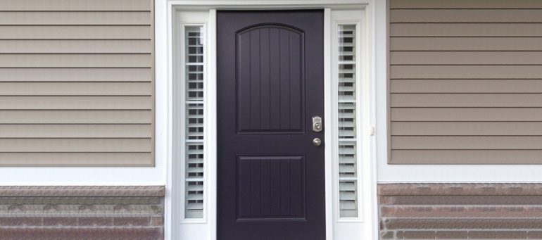 Entry Door Sidelight Shutters Next To Black Door In Phoenix, AZ