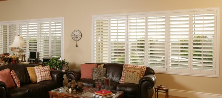 Wide window with interior shutters in Phoenix living room